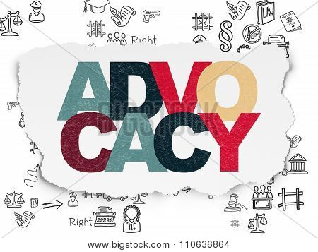 Law concept: Advocacy on Torn Paper background