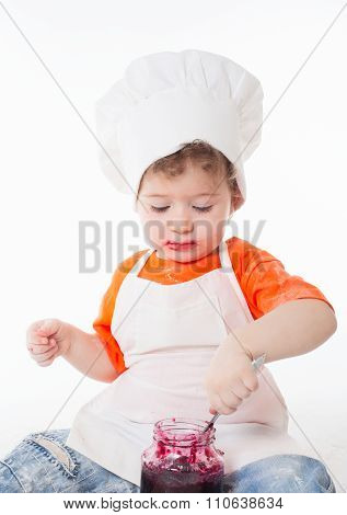 Baby Chef Eating Jam Isolated On White Background