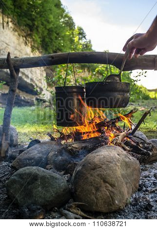 Man Stirs Ladle Food That Is Prepared In A Hike In The Cauldrons