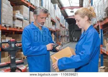 Man scanning parcel with handheld machine