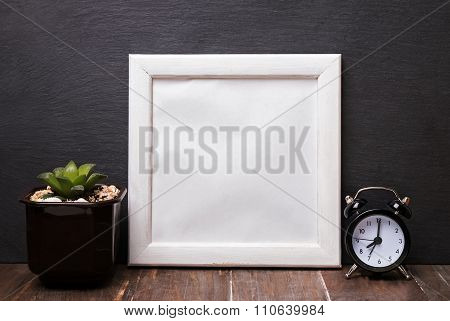 Blank White Frame, Alarm Clock And Succulent Plant.