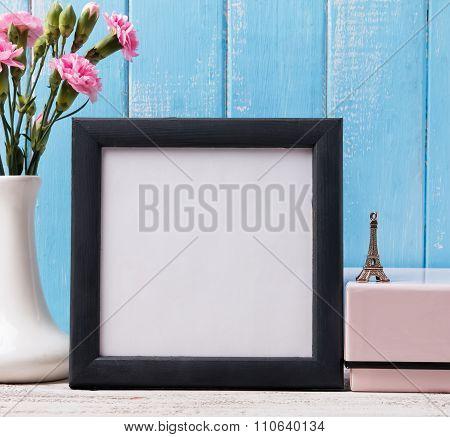Blank Frame, Pink Flower And Souvenir Eiffel Tower.