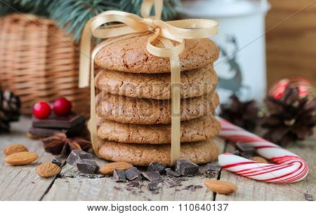 Spiced cookies with almonds. Christmas gifts. Round cookies, tied with ribbon and spruce branch in a