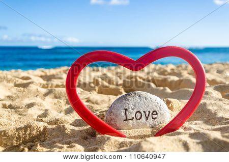 Sign Love With Heart On The Sandy Beach