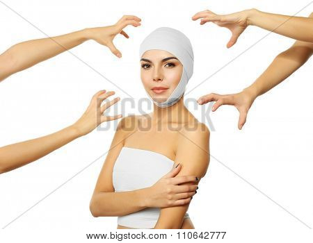 Young emotional woman with an elastic bandage on the head and hands around her, isolated on white