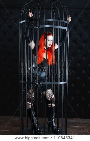 Girl With Red Hair Is Locked In A Cage.