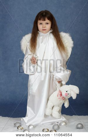 Little Girl Dressed As An Angel With Rabbit