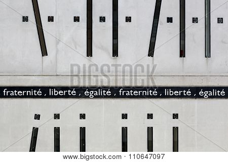 Liberty, Equality, and Fraternity on a wall, the motto of the french revolution