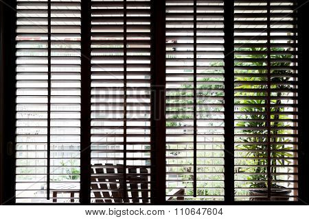 the window with Wooden horizontal jalousie dark