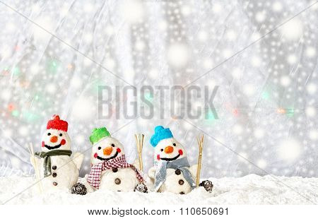 Christmas background with funny white and colorful snowmen