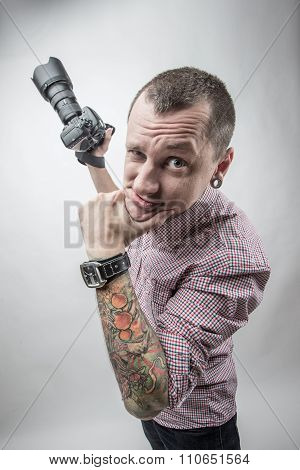 Tattooed funny guy with camera