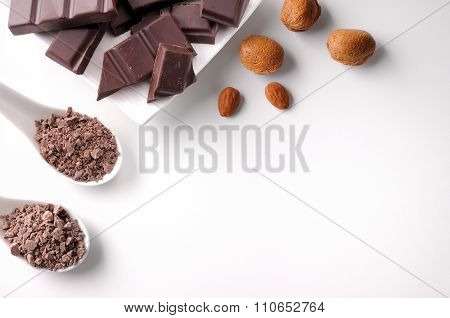 Portions And Chocolate Chips On Container With Almonds Isolated Top