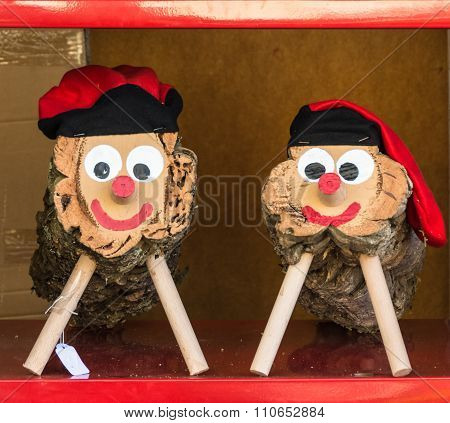 Caga tio the pooping log small log with a smiley face wearing the traditional red Catalan hat - the Barretina