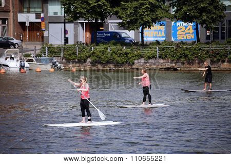 People Rowing Stand Up Paddleboard