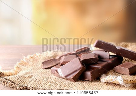 Heap Of Artisan Portions Chocolate On Burlap Front View