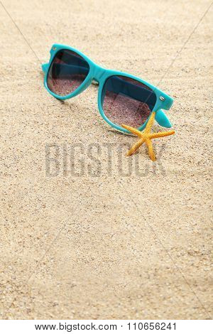 Starfish With Glasses On A Beach Sand