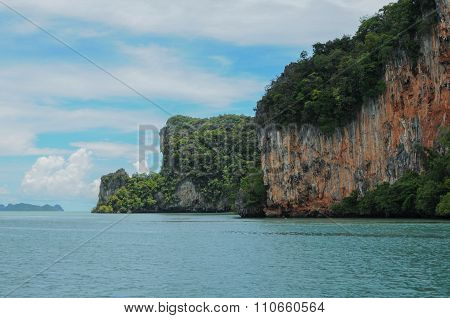 The Ochre Colours Of The Rock Glow In Reds And Browns. Islands At Phang Nga Bay Near Krabi And Phuke