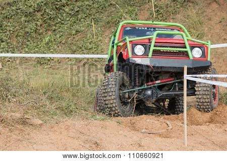 Front View Of Red And Green Off Road Car