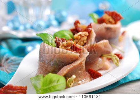 Appetizer Of Herring Rolls With Dried Tomato And Walnuts For Christmas