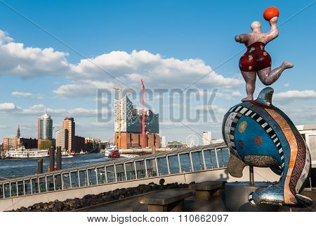 HAMBURG, GERMANY - May 1, 2013: Panorama view Hamburg port with Nana Sculpture.  Plastic of famous artist Niki de Saint Phalle in front of Theatre in Port and Elbphilharmonic Hall in background