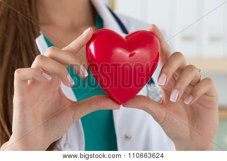 Close-up Of Female Doctor Hands Holding Read Heart