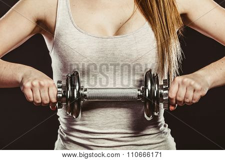 Closeup Of Strong Woman Lifting Dumbbells Weights.