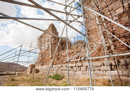 Scaffolding Of Metal Pipes Support Falling Brick Wall Of An Ancient Building