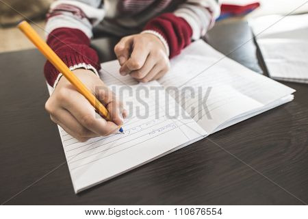 Child Write In A Notebook.