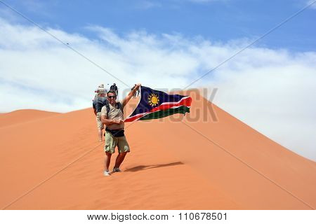 Man waving the flag of Namibia
