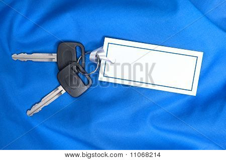 Car Keys And Gift Card On Blue