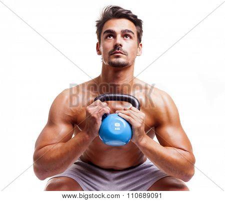 Fitness man lifing dumbbell on white background