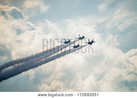Usaf Thunderbirds Flying Above The Clouds