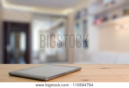 tablet on wooden table in the living room