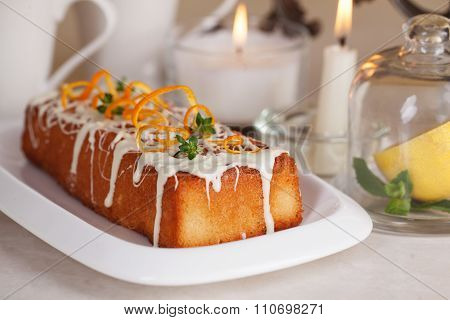 plum cake food white chocolate, orange zest, thyme, close-up still life with tea and lemon