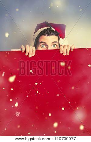 Surprised Santa Elf Holding Red Christmas Board