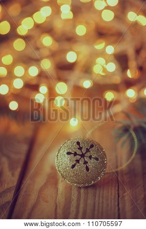 Metal Jingle Bell With Star On Wooden Table. Retro Christmas Bac