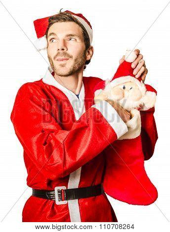 Santa Stocking Up On Christmas Gifts