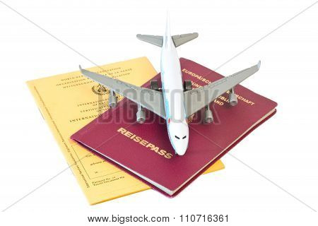 Toy Plane On Passport And Vaccination Card