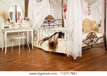 Lifeless Woman Lying On A Bed