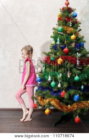 Confused Little Girl Near Christmas Tree