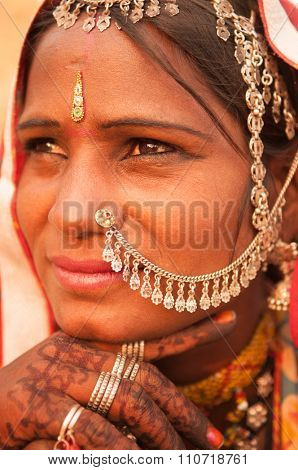 Beautiful Traditional Indian woman in sari costume covered her head with veil, India people