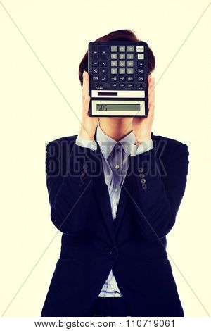 Hopeless businesswoman with SOS writing on calculator.