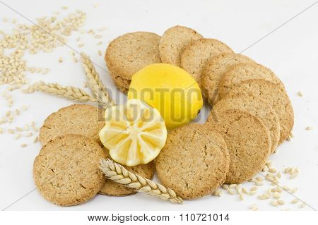 Integral Biscuits And Decorated Lemon On White Background