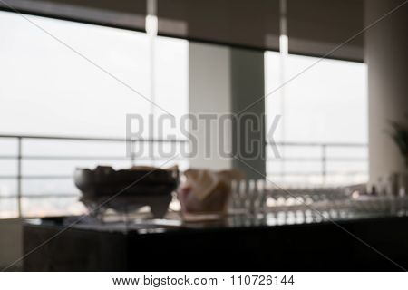 Blurred Defocussed Abstract Background Of Glasses On The Table For Drinks Cocktails Setup