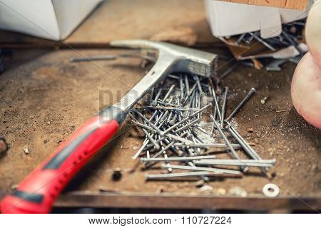 Close-up Of Professional Hammer, Nails And Construction Tools On Workbench