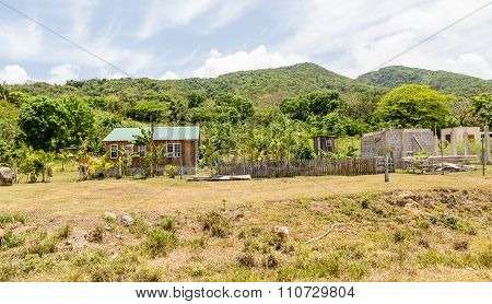 Tropical Bungalow With Goats