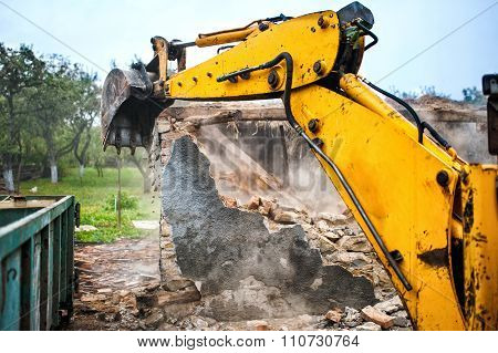Bulldozer And Excavator Demolishing Concrete Brick Walls