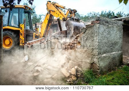 Bulldozer Demolishing Concrete Brick Walls Of Small Building