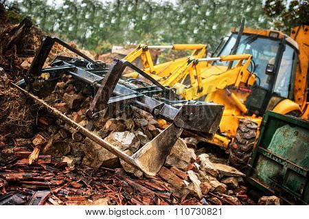 Excavator Loading Demolition Debris And Concrete Wasted Walls
