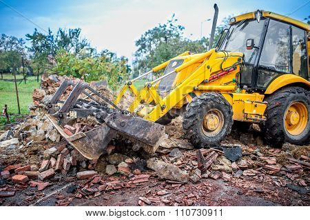 Bulldozer Working At Demolition Site, Cleaning Debris Of Bricks